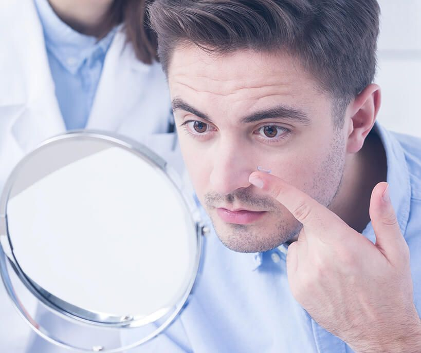 man putting in a contact lens