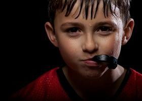 kid with a mouth guard