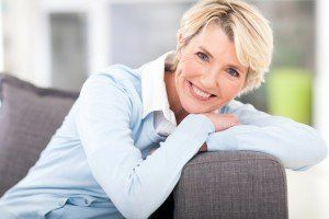 smiling woman in couch
