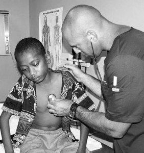 doctor checking the health of a child patient