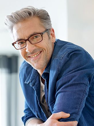 smiling man with eyeglasses