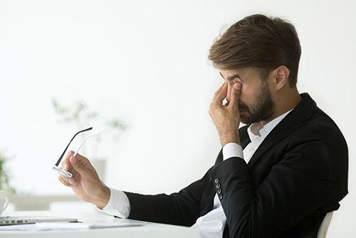 Guy scratching his eyes