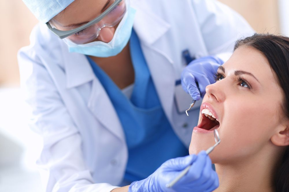Dentist working on patient