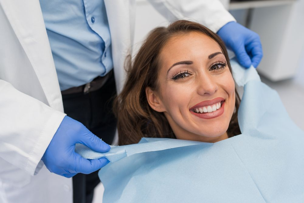 Smile Makeovers with Porcelain Veneers and Crowns