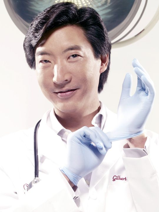 Dr. Gilbert Lee in surgical gloves