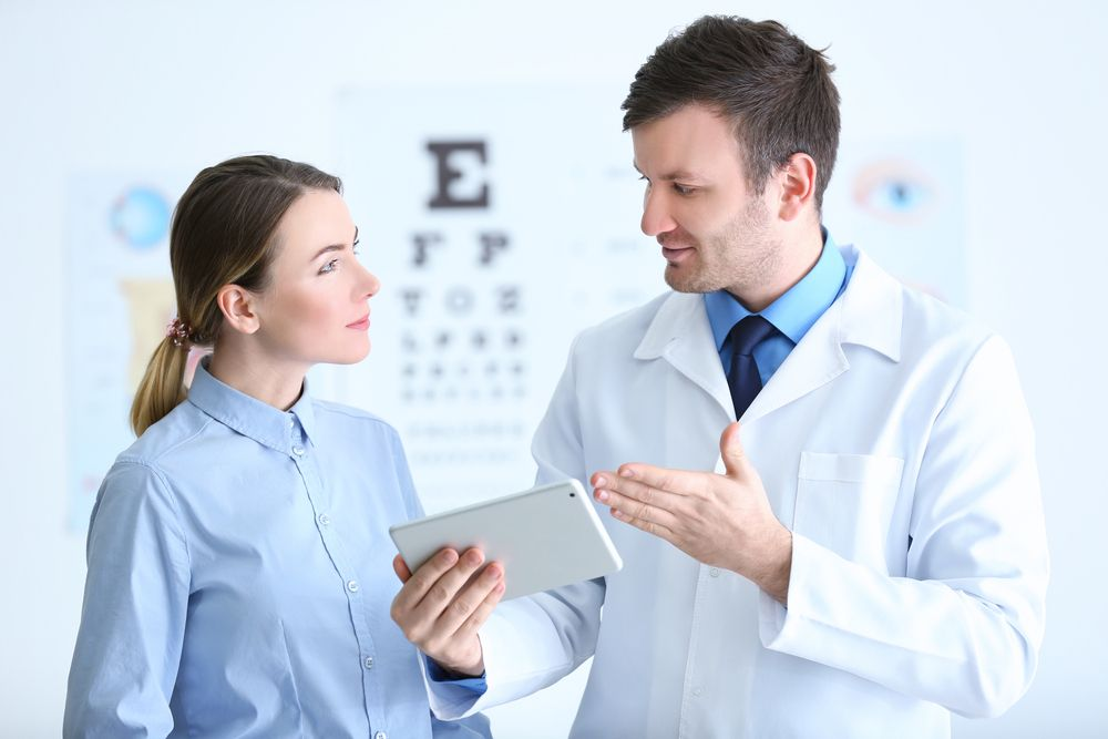 woman listening to her eye doctor