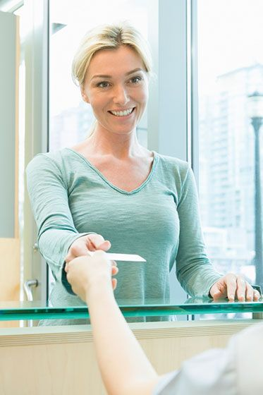 woman at the counter smiling