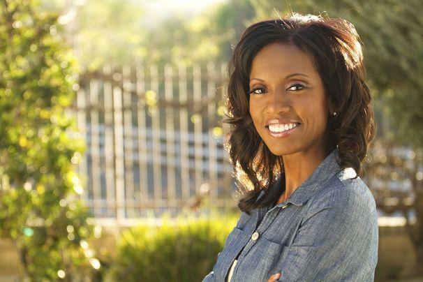 African American woman smiling in her garden