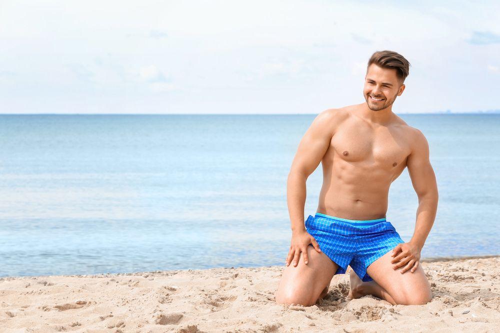 shirtless man on the beach