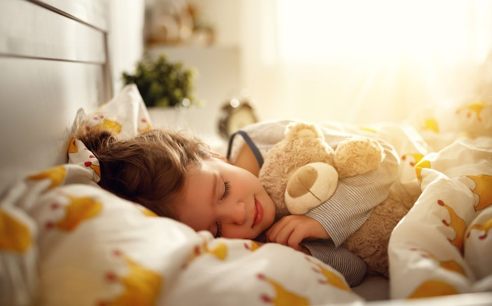 child sleeping with Ortho-K contact lenses in