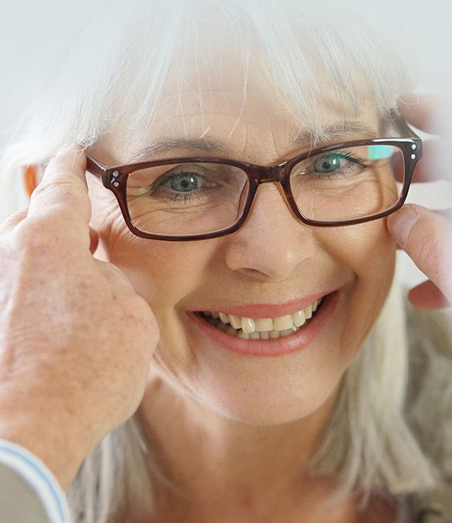 Grand mother having a pair of eye glasses